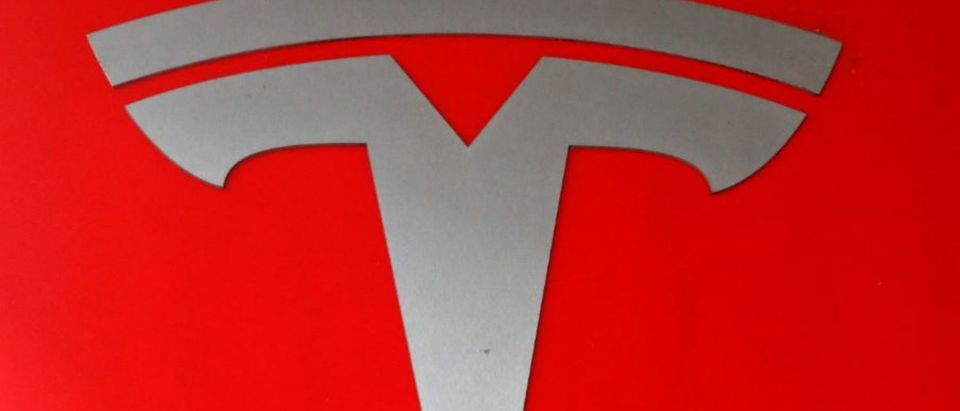 The company logo is seen in front of a showroom of U.S. car manufacturer Tesla in Zurich, Switzerland March 28, 2018. REUTERS/Arnd Wiegmann