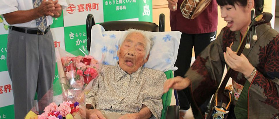 This picture received from Kikaicho Town Hall via Jiji Press and taken on September 18, 2017 shows 117-year-old Nabi Tajima (2nd L) in Kikaicho on Kikai island of Kagoshima prefecture. - A 117-year-old Japanese woman, thought to be the world's oldest person, has died, a local official told AFP on April 22, 2018. Nabi Tajima, who was born August 4, 1900, died around 8:00 pm (1100 GMT) on April 21 at a hospital on her native Kikai Island in Kagoshima region, according to Susumu Yoshiyuki, a health and welfare official. (Photo by JIJI PRESS / KIKAI TOWN VIA JIJI PRESS / AFP) / Japan OUT (Photo credit should read JIJI PRESS/AFP/Getty Images) | The World's Oldest Person Dead At Age 117