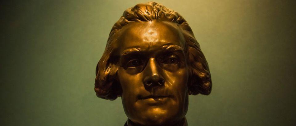 Washington DC, USA - August 27, 2016: Thomas Jefferson Memorial with closeup of bronze statue (Shutterstock/Andriy Blokhin)