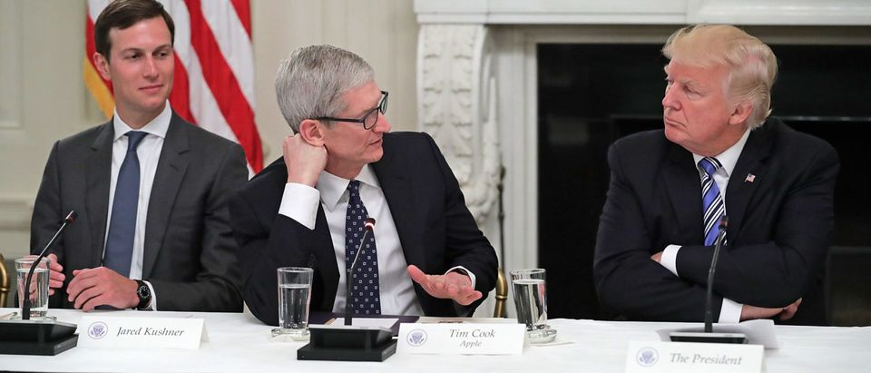 """WASHINGTON, DC - JUNE 19: Apple CEO Tim Cook delivers brief remarks as U.S. President Donald Trump (R) and White House Director of the Office of American Innovation and the president's son-in-law Jared Kushner listen during a meeting of the American Technology Council in the State Dining Room of the White House June 19, 2017 in Washington, DC. According to the White House, the council's goal is """"to explore how to transform and modernize government information technology."""" (Photo by Chip Somodevilla/Getty Images)"""