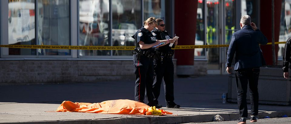 A tarp covers an unidentiified body on Yonge St. at Finch Ave. after a van plowed into pedestrians on April 23, 2018 in Toronto, Ontario, Canada. A suspect is in custody after a white van collided with multiple pedestrians killing nine and injuring at least 16. (Photo by Cole Burston/Getty Images) | Toronto Mayor: 'Inclusive' City Post-Attk