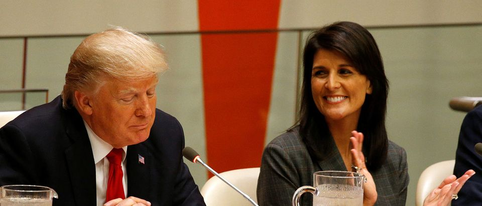 U.S. Ambassador the the U.N. Nikki Haley applauds as U.S. President Donald Trump speaks during a session on reforming the United Nations at U.N. Headquarters in New York