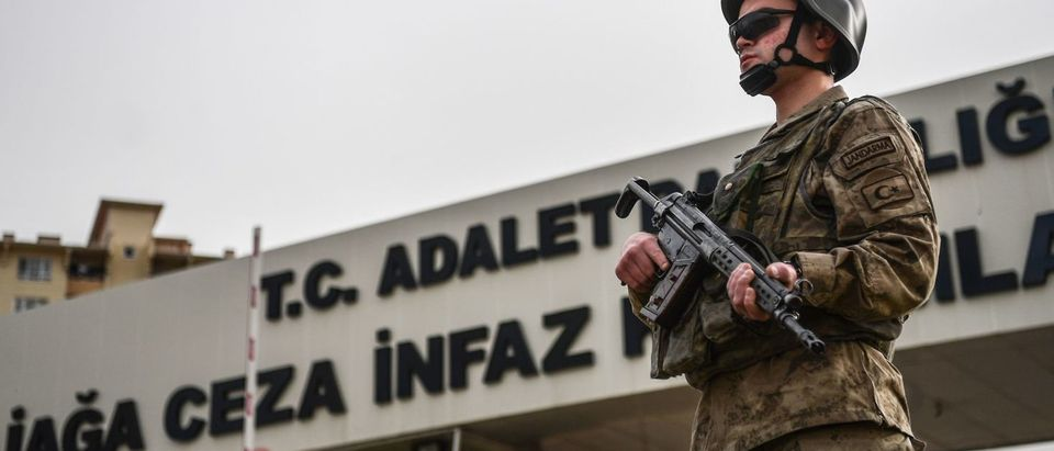 A Turkish soldier stands guard at the entrance of the Aliaga court and prison complex, during the trial of US pastor Andrew Brunson, held on charges of aiding terror groups, in Aliaga, north of Izmir, on April 16, 2018. An American pastor went on trial in Turkey on April 16 on terror-related charges after spending the last one-and-a-half years behind bars, in a case that has increased friction between Ankara and Washington. Andrew Brunson, who ran a church in the western city of Izmir and was detained in October 2016, was present in court as the trial opened in the town of Aliaga north of Izmir. (Photo: OZAN KOSE/AFP/Getty Images)