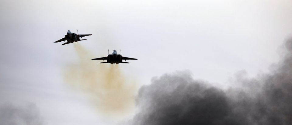 Israeli Air Force F-15 planes fly during an aerial demonstration at a graduation ceremony for Israeli air force pilots at the Hatzerim air base in southern Israel