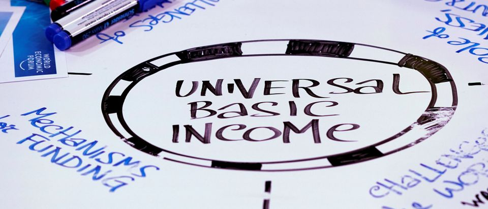 Universal Basic Income is written on a table during a session at the World Economic Forum annual meeting in Davos, Switzerland January 23, 2018 REUTERS/Denis Balibouse
