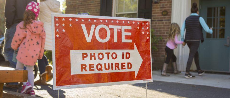 ARLINGTON, VIRGINIA, USA - NOVEMBER 8, 2016: Voters on presidential election day. (Shutterstock)