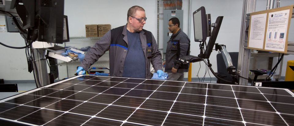 Production operator John White checks a panel at the SolarWorld solar panel factory in Hillsboro, Oregon, U.S., January 15, 2018. Picture taken January 15, 2018. REUTERS/Natalie Behring | Trump Tariffs Helping Solar Industry