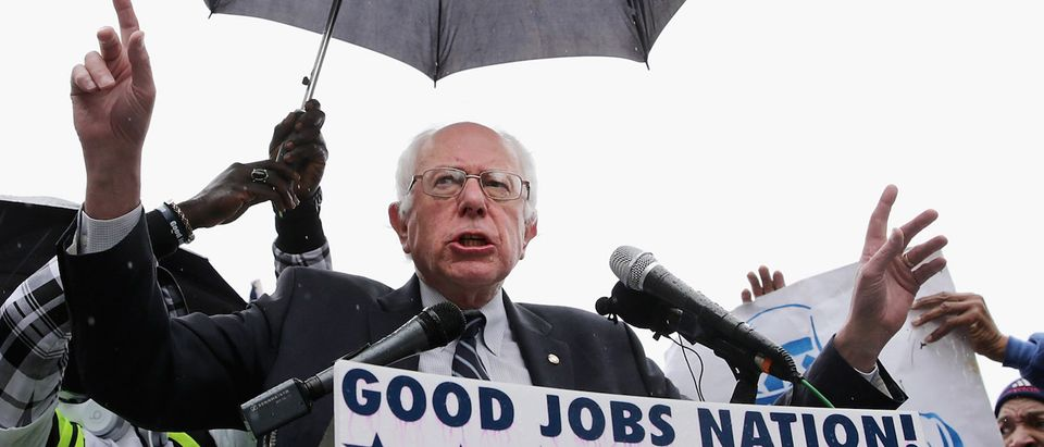 Democratic presidential candidate Sen. Bernie Sanders (I-VT) (C) addresses a rally with protesters calling for higher wages for federal contract workers in the rain on Capitol Hill November 10, 2015 in Washington, DC. (Photo: Chip Somodevilla/Getty Images)