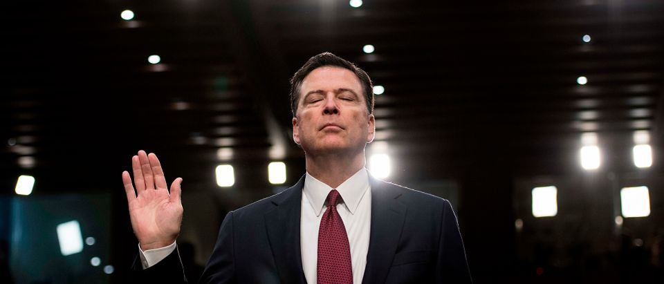 Ousted FBI director James Comey is sworn in during a hearing before the Senate Select Committee on Intelligence on Capitol Hill June 8, 2017 in Washington, DC. Fired FBI director James Comey took the stand Thursday in a crucial Senate hearing, repeating explosive allegations that President Donald Trump badgered him over the highly sensitive investigation Russia's meddling in the 2016 election. / AFP PHOTO / Brendan Smialowski (Photo credit should read BRENDAN SMIALOWSKI/AFP/Getty Images)