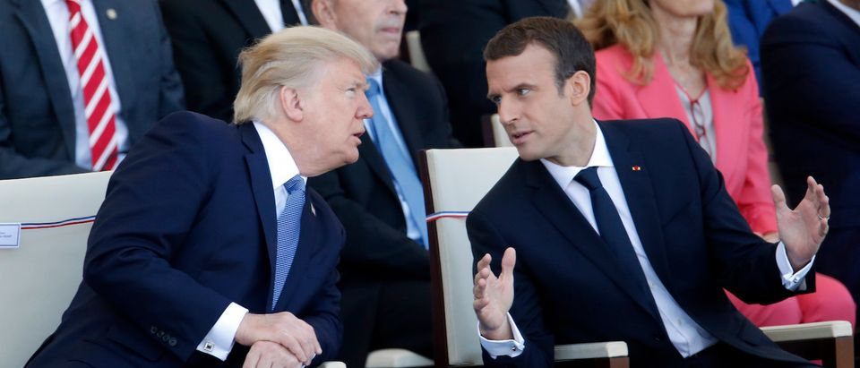 President Donald Trump and French President Emmanuel Macron attend the traditional Bastille day military parade on the Champs-Elysees on July 14, 2017 in Paris France. (Photo: Thierry Chesnot/Getty Images) | Macron Wants The US To Fight In Syria