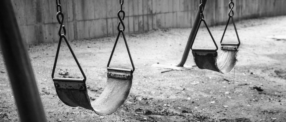 empty swings Shutterstock/Yukontorn