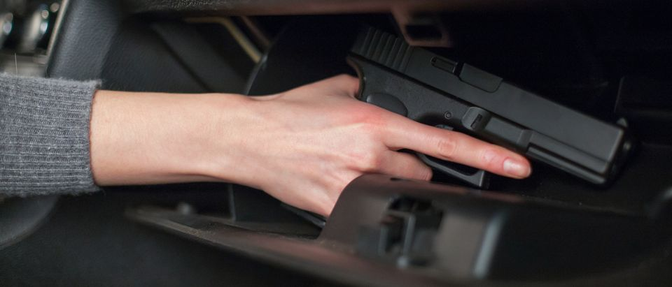 handgun in a glove compartment (Shutterstock/VasiliyBudarin)