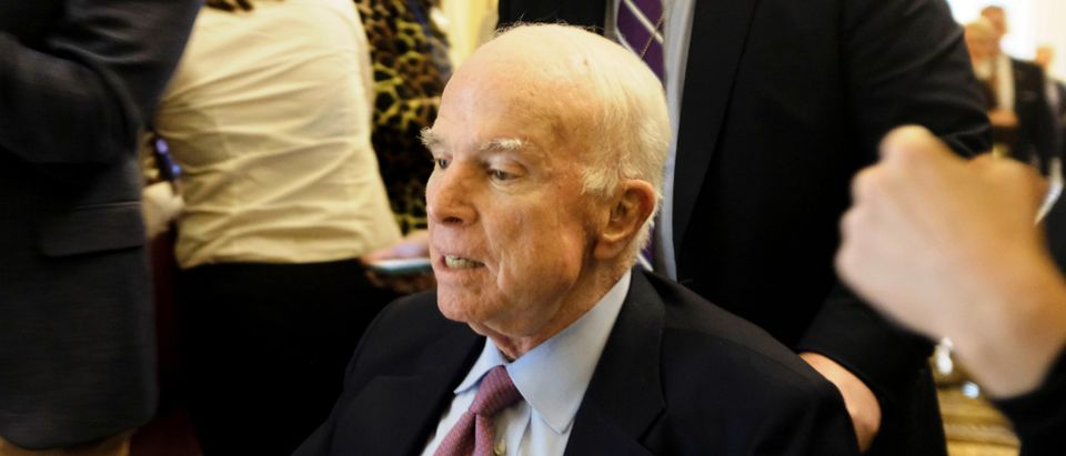 U.S. Senator John McCain (R-AZ) leaves the Senate floor in a wheelchair during debate over the Republican tax reform plan in Washington, U.S., December 1, 2017. REUTERS/James Lawler Duggan - RC1F79DC35A0