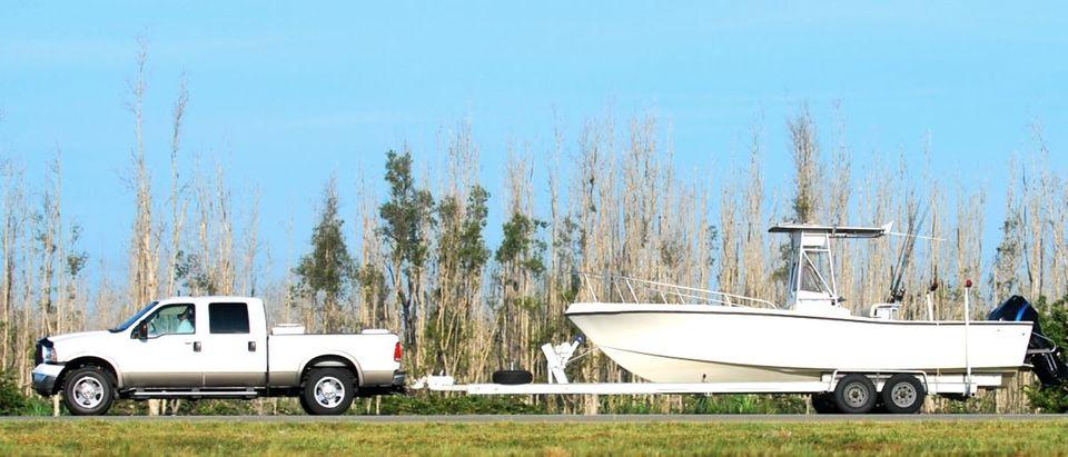 pickup truck with boat Shutterstock/Ivan Cholakov