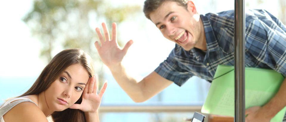 Guy Stalking Woman (Shutterstock/Antonio Guillem) | Eric Greitens Wife Talks Stalker
