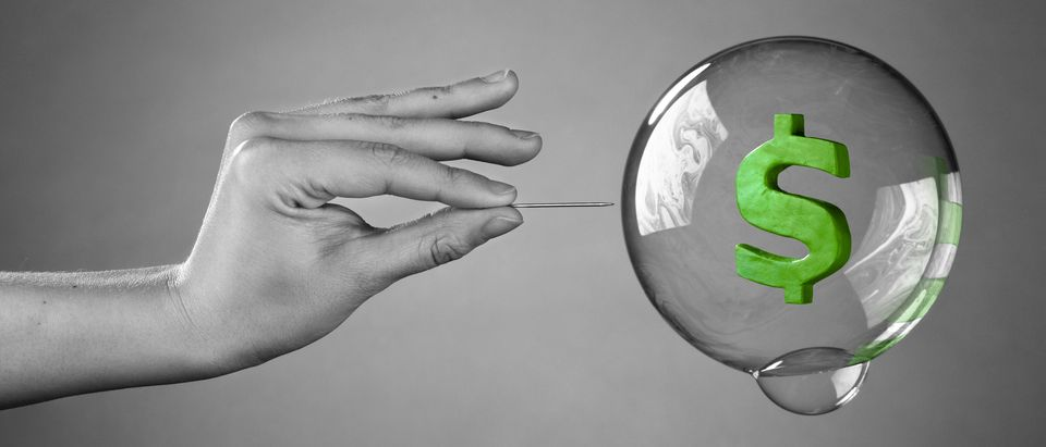 About to burst the bubble. Financial Crisis Concept. (Shutterstock)