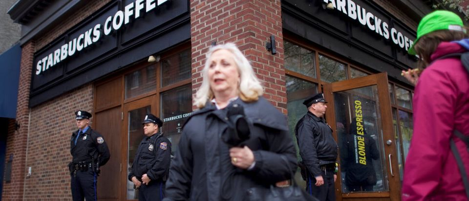 Police officers monitor activity outside as protestors demonstrate inside a Center City Starbucks, where two black men were arrested, in Philadelphia, Pennsylvania U.S. April 16, 2018. REUTERS/Mark Makela