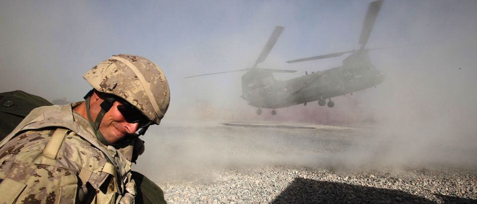 A Canadian CH-47 Chinook helicopter lands to pick up Canadian soldiers leaving forward fire base Zangabad