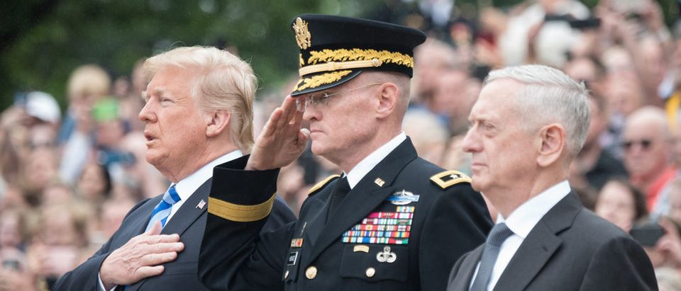 President Donald J. Trump, Commanding General of the Military District of Washington U.S. Army Maj. Gen. Michael L. Howard, and Secretary of Defense James N. Mattis render honors during the Presidential Wreath Laying ceremony at the Tomb of the Unknown Soldier as part of the 150th annual Department of Defense (DoD) National Memorial Day Observance hosted by the Secretary of Defense at Arlington National Cemetery, May 28, 2018. Senior leadership from around the DoD gathered to honor AmericaÕs fallen military service members. (DoD Photo by U.S. Army Sgt. James K. McCann)