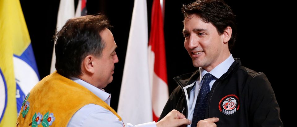 Canada's PM Trudeau receives a jacket from National Chief Bellegarde during AFN Special Chiefs Assembly in Gatineau