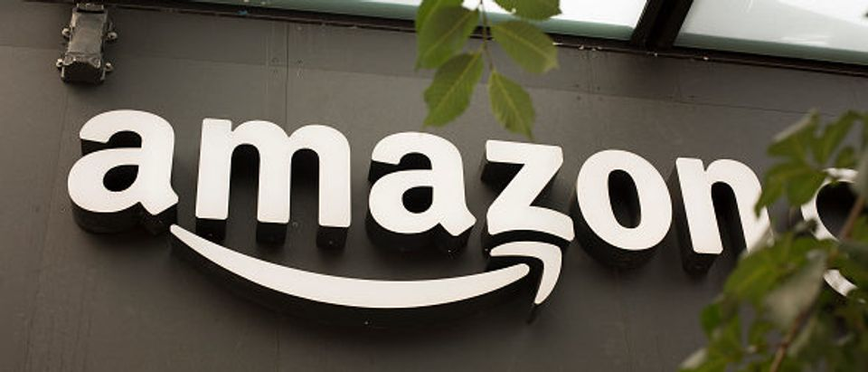 A portion of the sign advertising Amazon Go is seen outside the grocery store's location on June 16, 2017 in Seattle, Washington. (Photo by David Ryder/Getty Images)