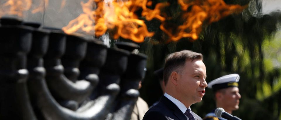 Poland's President Andrzej Duda speaks during a ceremony commemorating the 75th anniversary of the Warsaw Ghetto Uprising, in front of the Warsaw Ghetto monument in Warsaw, Poland April 19, 2018. REUTERS/Kacper Pempel | Poland Wants To Pay US For Military Base