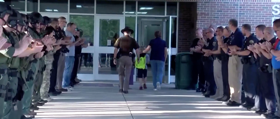 Boy returns to school to be greeted by 70 police officers