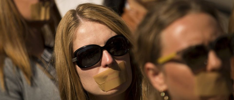 Journalists protest against censorship with taped mouths. [Shutterstock - Veselin Borishev] | Conservatives Protest Big Tech Censorship