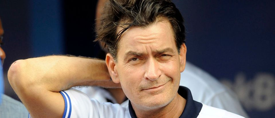 Actor Charlie Sheen throws out the ceremonial first pitch prior to MLB game action between the Toronto Blue Jays and Chicago White Sox August 14, 2012 at Rogers Centre in Toronto, Ontario, Canada. (Photo by Brad White/Getty Images)