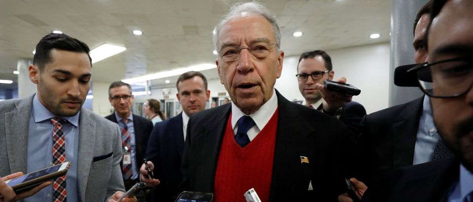 Sen. Chuck Grassley speaks with reporters ahead of votes on Capitol Hill in Washington