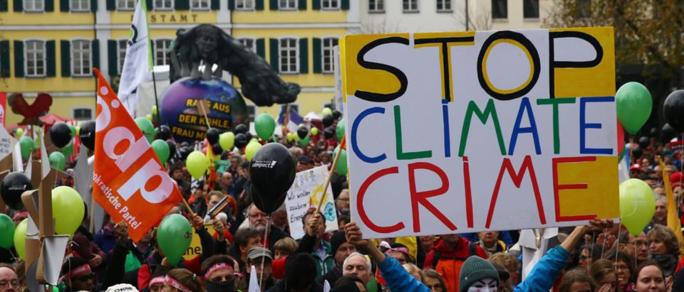 "People march during a demonstration under the banner ""Protect the climate - stop coal"" two days before the start of the COP 23 UN Climate Change Conference hosted by Fiji but held in Bonn, Germany November 4, 2017. REUTERS/Wolfgang Rattay 