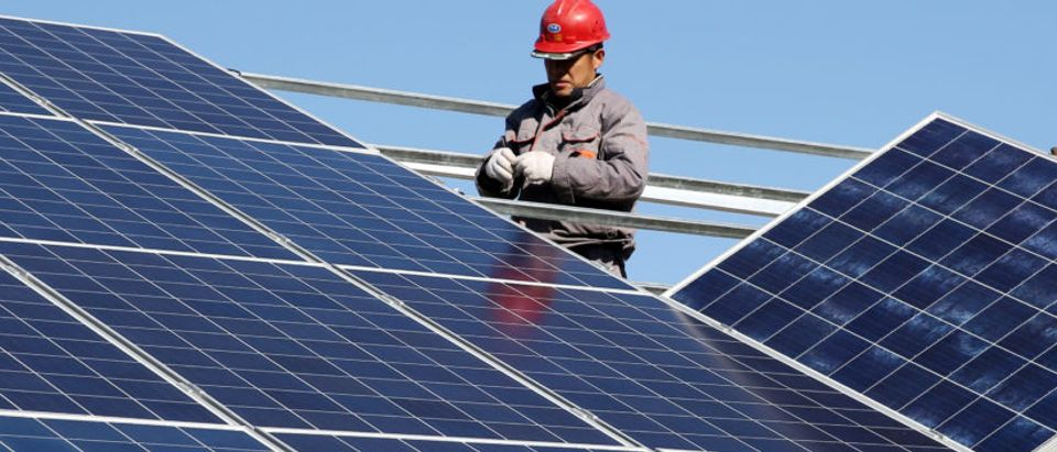 Workers install solar panels at a residential home in a village in Dongying, Shandong province, China November 22, 2017. Picture taken November 22, 2017. REUTERS/Stringer | Connecticut Reforms Net Metering