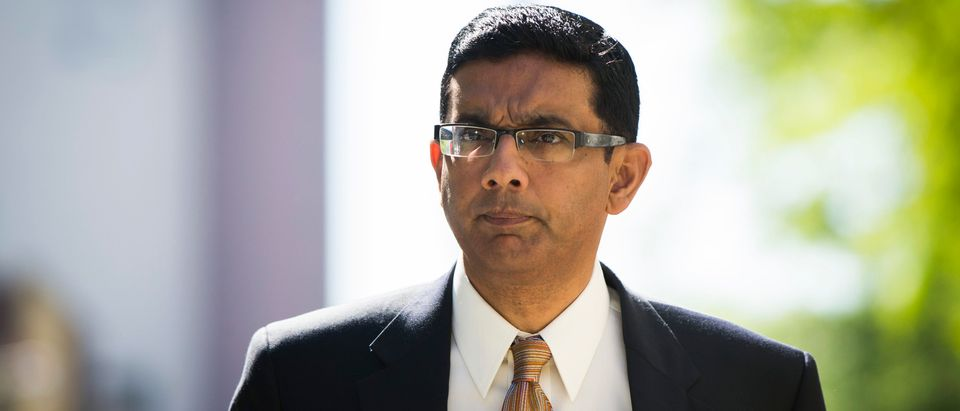 Conservative commentator and best-selling author Dinesh D'Souza exits the Manhattan Federal Courthouse after pleading guilty in New York, May 20, 2014. REUTERS/Lucas Jackson