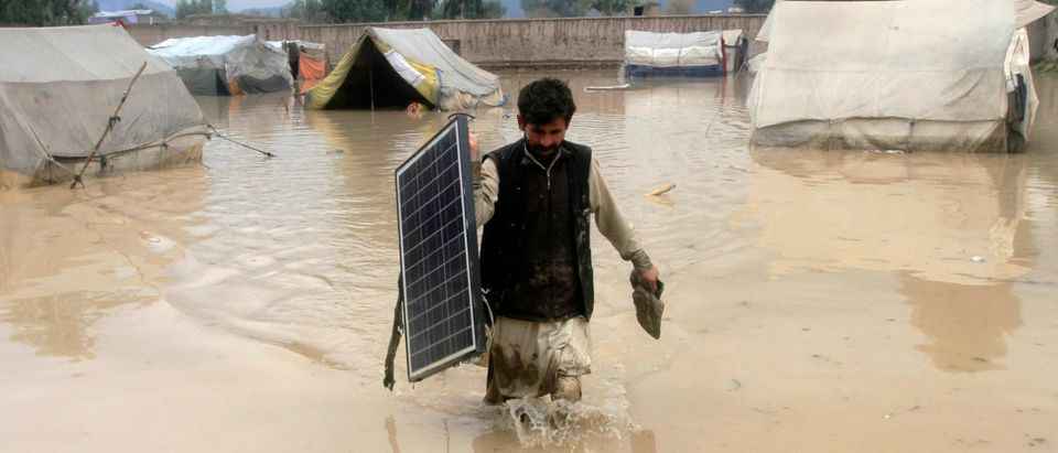 An Afghan man carries a solar panel as he wades through flood waters in the Behsud District of Nangarhar province, February 25, 2015. Four people were killed and hundred houses have been damaged after a heavy rain and flood in Nangarhar province of Afghanistan, the provincial spokesman Ahmadzia Abdulzai said. REUTERS/Parwiz (AFGHANISTAN - Tags: DISASTER ENVIRONMENT TPX IMAGES OF THE DAY) - GM1EB2P1QRM01 | Solar Panels Carry Toxic Chemicals