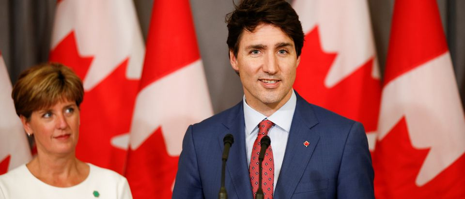 Canada's Prime Minister Justin Trudeau and Canada's Minister for International Development Marie-Claude Bibeau attend a news conference at Canada's Embassy in London