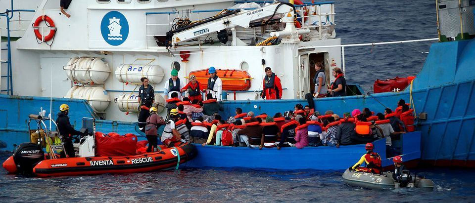 "Migrants on a wooden boat are rescued by German NGO Jugend Rettet ship ""Juventa"" crew in the Mediterranean sea off Libya coast"