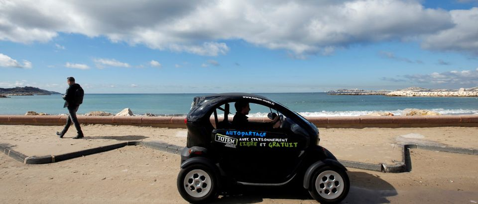 A man drives a Totem-Mobi electric car-sharing vehicle in Marseille