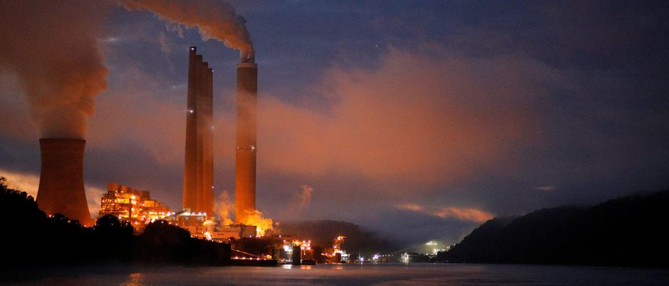 FILE PHOTO: The Dayton Power & Light J.M. Stuart Station lights up the early morning sky on the banks of the Ohio River in Aberdeen