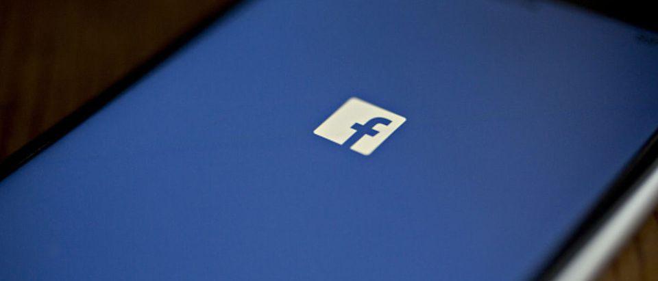 Facebook App And Logo As Crisis Reignites Washington Scrutiny Of Social Networks