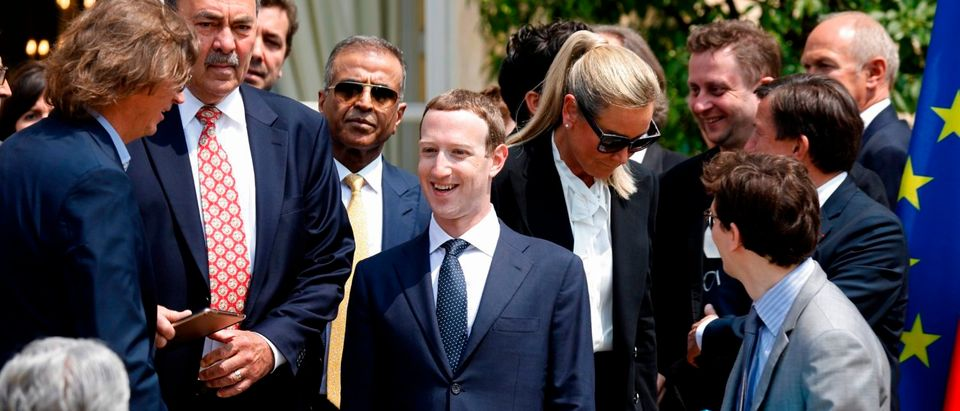 """Facebook's CEO Mark Zuckerberg (C) arrives for a family picture with guests of the """"Tech for Good"""" Summit at the Elysee Palace in Paris, on May 23, 2018. (Photo: CHARLES PLATIAU/AFP/Getty Images)"""