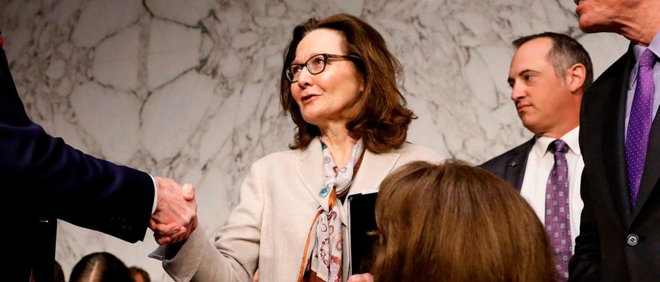 Acting CIA Director Gina Haspel is greeted by Senator Ron Wyden (D-OR) as she arrives to testify at her Senate Intelligence Committee confirmation hearing on Capitol Hill in Washington, U.S., May 9, 2018. REUTERS/Aaron P. Bernstein - HP1EE5915GSWT