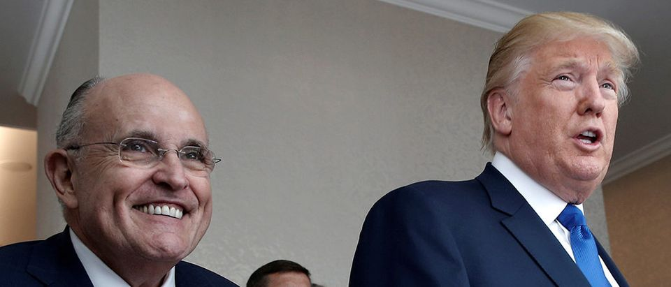 FILE PHOTO: Donald Trump walks with former New York City Mayor Rudolph Giuliani through the new Trump International Hotel in Washington