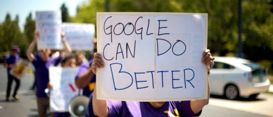 A protestor holds a sign while demonstrating outside at Google's headquarters in June, 2013. Yelp and TripAdvisor have formed a coalition to asked Google employees to make Google's search results fair for competitors. (Photo: Noah Berger/Bloomberg via Getty Images)