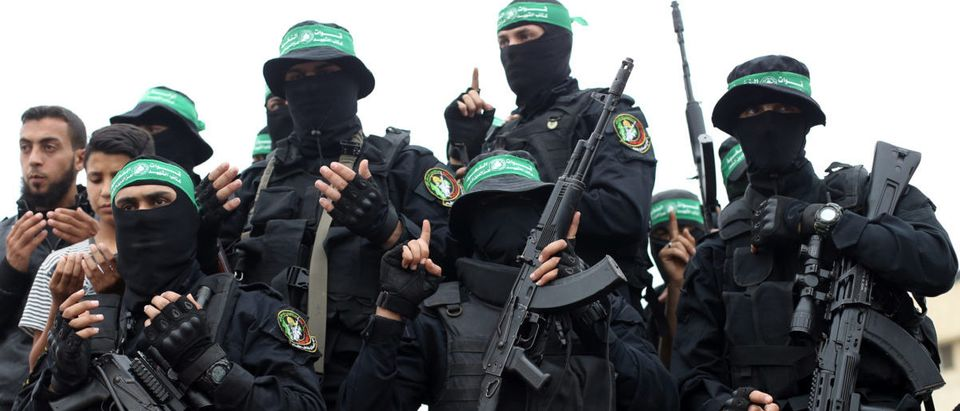 Palestinian Hamas militants attend the funeral of their comrades who were killed in an explosion, in the central Gaza Strip May 6, 2018. REUTERS/Ibraheem Abu Mustafa