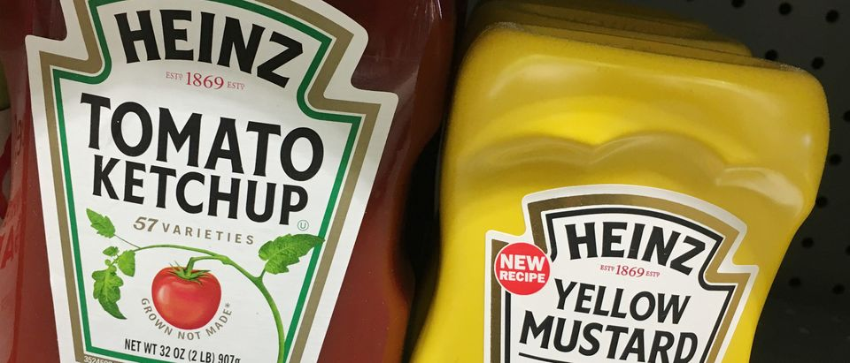 Heinz tomato ketchup and yellow mustard bottles are seen for sale at a store in Manhattan, New York, April 29, 2016. REUTERS/Shannon Stapleton
