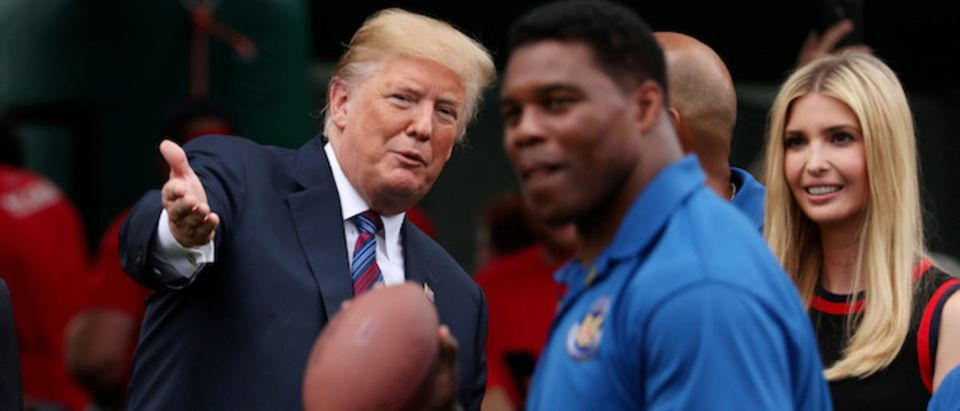 President Trump and Ivanka watch Herschel Walker throws pass at White House Sports and Fitness Day in Washington