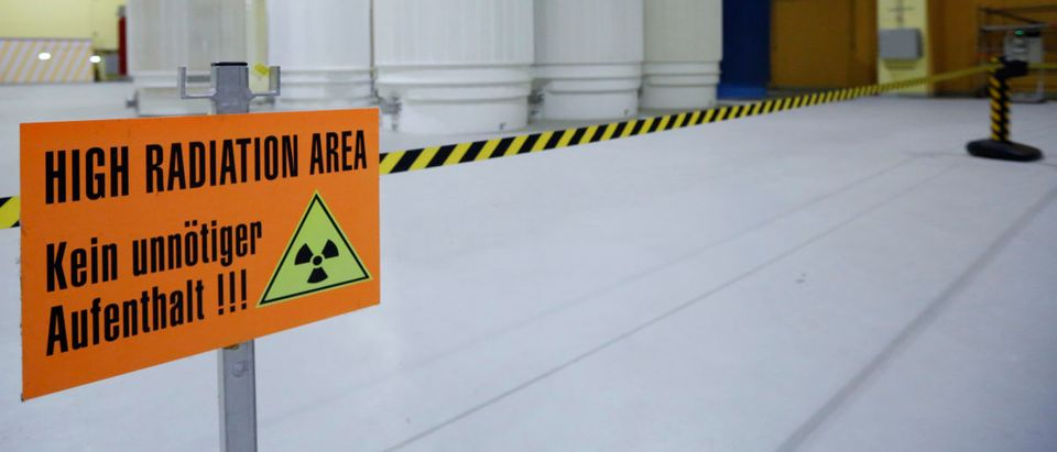 A sign that reads 'High Radiation Area - Avoid unnecessary stay!!!' is pictured in front of Castor nuclear waste containers in Wuerenlingen