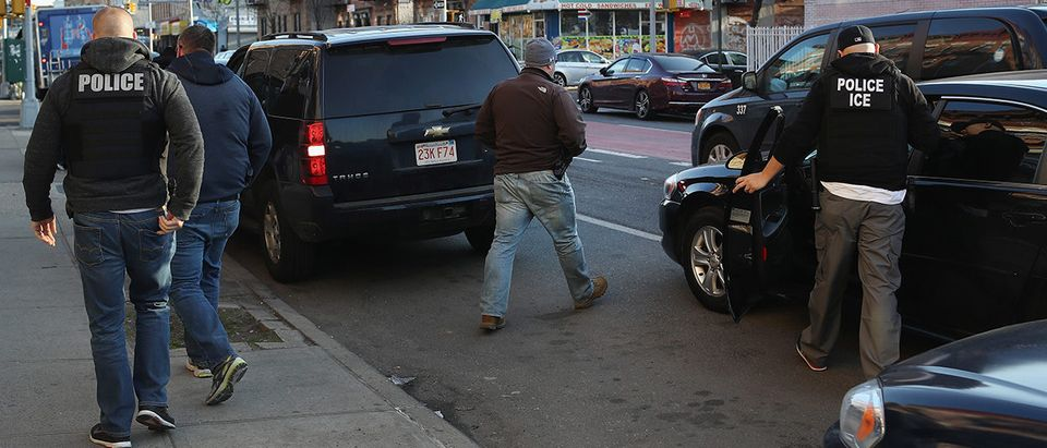 "U.S. Immigration and Customs Enforcement (ICE), officers depart after an operation to arrest an wanted undocumented immigrant on April 11, 2018 in the Brooklyn borough of New York City. New York is considered a ""sanctuary city"" for undocumented immigrants, and ICE receives little or no cooperation from local law enforcement. ICE said that officers arrested 225 people for violation of immigration laws during the 6-day operation, the largest in New York City in recent years. (Photo by John Moore/Getty Images)"