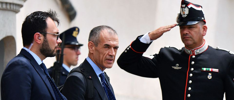 Italian economist, formerly with the International Monetary Fund, Carlo Cottarelli leaves the Qurinale presidential palace on May 28, 2018 in Rome after a meeting with Italian President that gave him the mandate to form a new government. - Italy's president appointed pro-austerity economist Carlo Cottarelli, 64, is to form a potential technocrat government as the country lurched into fresh political chaos following the collapse of a populist bid for power. ALBERTO PIZZOLI/AFP/Getty Images   What Is Italy's Political Crisis About?