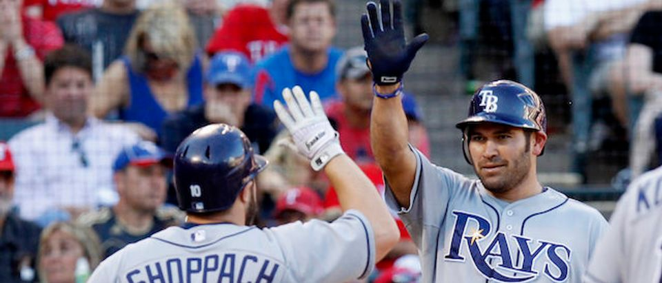 Rays' Kelly Shoppach is congratulated by teammate Damon after he hit a two run home run in the fifth inning against the Texas Rangers during Game 1 of their MLB American League Division Series baseball playoffs at Rangers Ballpark
